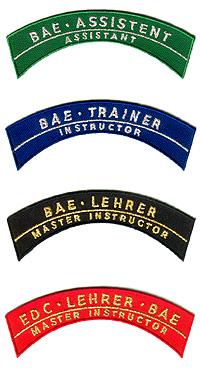 Abzeichen für Assistenten, Trainer, Lehrer und EDC-Lehrer